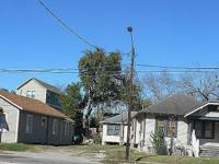 This listing consist of 3 Bungalow homes on 2 lots. 717