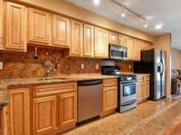 Enjoy this beautiful townhouse style condo duplex with