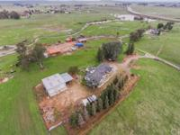 Charming ranch home on 65 acres priced to sell. This
