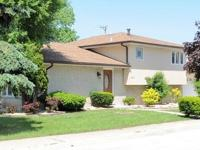 Beautiful split level home with attached two car