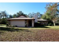 Located on a 3/4 Acre corner lot in the Estate area of
