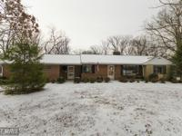 All brick rambler with 3 bed/2 bath and oversized 2 car