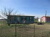 Enjoy the country life in this quaint home on almost an