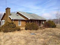 Ranch style home with full basement, Wood siding, walk