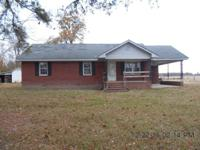 Brick ranch on large, country lot. Large living room,