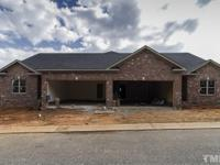 New custom built, all brick townhome walking distance