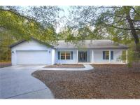 This 3/2/2 home is situated on 5 wooded acres! Zoned