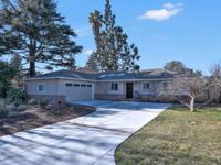 Custom-built home in Caputo Acres on a wide tree-lined