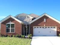 Enjoy carefree living in this Drees Alexander ranch,