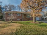 Welcome Home! This Brick Ranch situated on a quiet