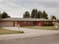 Butte Country Club Area brick rancher with almost 3000