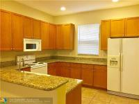 Large town home in gated community with impact windows,