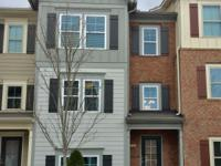 Elegant 3 story brick 3 bedroom, 3.5 bath, like-new