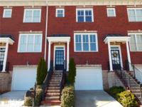 This amazing Brookhaven upgraded 3 story townhome has