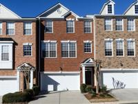 Pristine 3 bedroom/3.5 bath townhome in beautiful gated