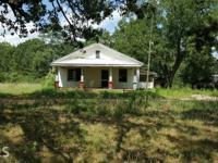 12 Acres to be developed. House must be demolished. The