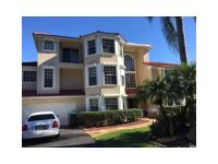 Lakefront custom three story gated estate pool home on