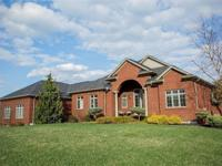 Luxurious custom ranch with architectural columns,