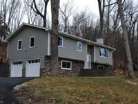Totally updated turn key Bilevel on wooded one acre