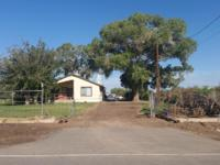 4.75 acres of irrigated land with a 3 bedroom 3 bath