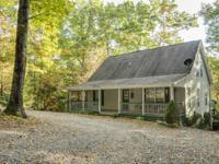 Tucked away on a beautiful 4.3 Acre lot with hardwood