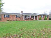 Full brick ranch on acreage! Country living, close to