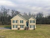 Wonderful split on 3.29 acres - woods for privacy, yet