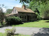 Great vintage cape on 3.41 acres with a large two story