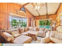 Charming 3/3 home sits on 100' feet of deep-water