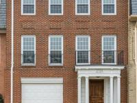 Elegant, multi-level brick townhouse in desirable