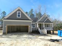 Beautiful open RANCH plan with bonus room above garage!