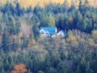Private country estate on 10 wooded acres sitting atop