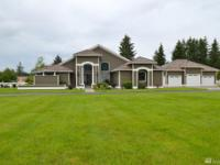 Absolutely superb custom home on 5.30 acres with a