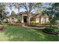Immaculate custom home in gated Winter Park community.