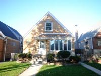 Well maintained light-brick 1.5 story in Archer Heights