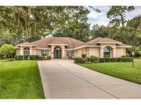 Fairways in Wildwood- home is situated on 3/4 ACRE for