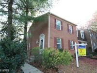 Gorgeous Updated Brick End unit Townhouse with New