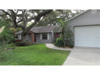 Beautiful Seminole home with caged, heated lap pool and