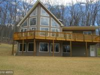 ***spectacular new chalet near paved road on 3/4 acre