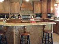 Custom built home situated on 18 acres with fencing for