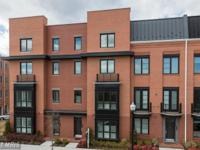 Stunning like-new 4-level townhome at potomac yard.