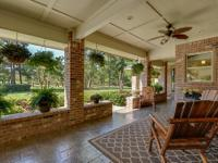 Texas-sized 1.5-story home on 8.24 unrestricted acres.