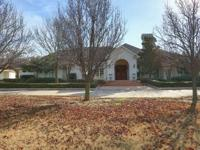 Custom home located on 12 acres just an hour drive from