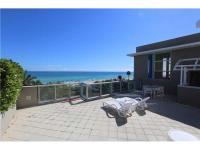 Rarely available! Modern 3-story OCEANFRONT TOWNHOME