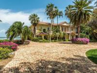 This gated Mediterranean Masterpiece stretches out on