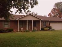Brick home located in Holly Brook Estates. Not far from