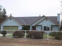 This lovely custom built home built in 2003 sits on