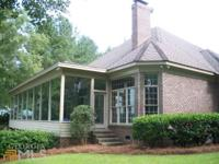 Lake front home on 2 lots on beautiful Brannen Lake.