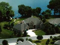 Executive home on 140' of Willmar Lake! The search is