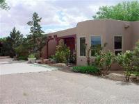 Exquisite pueblo-style home on 13.77 acres! Features